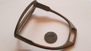 Brass stirrup and 1917 penny